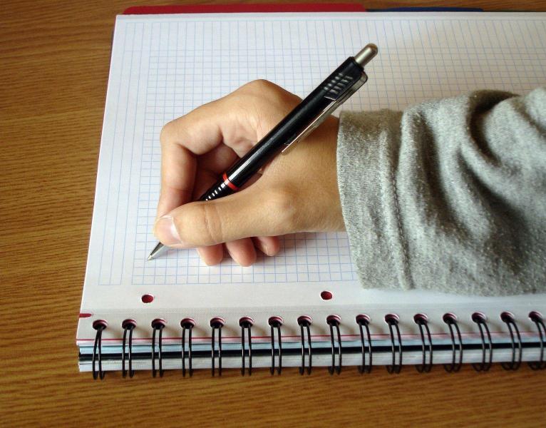 A hand writing 1238539